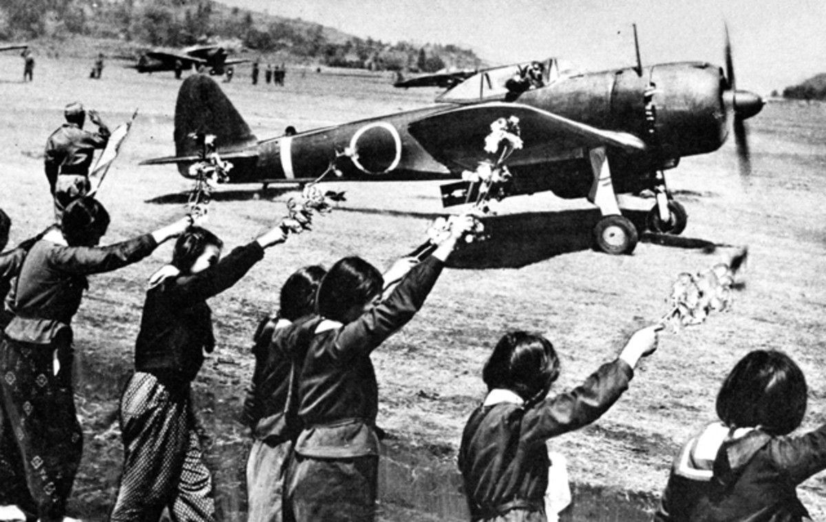 High school girls waving farewell to a kamikaze pilot.