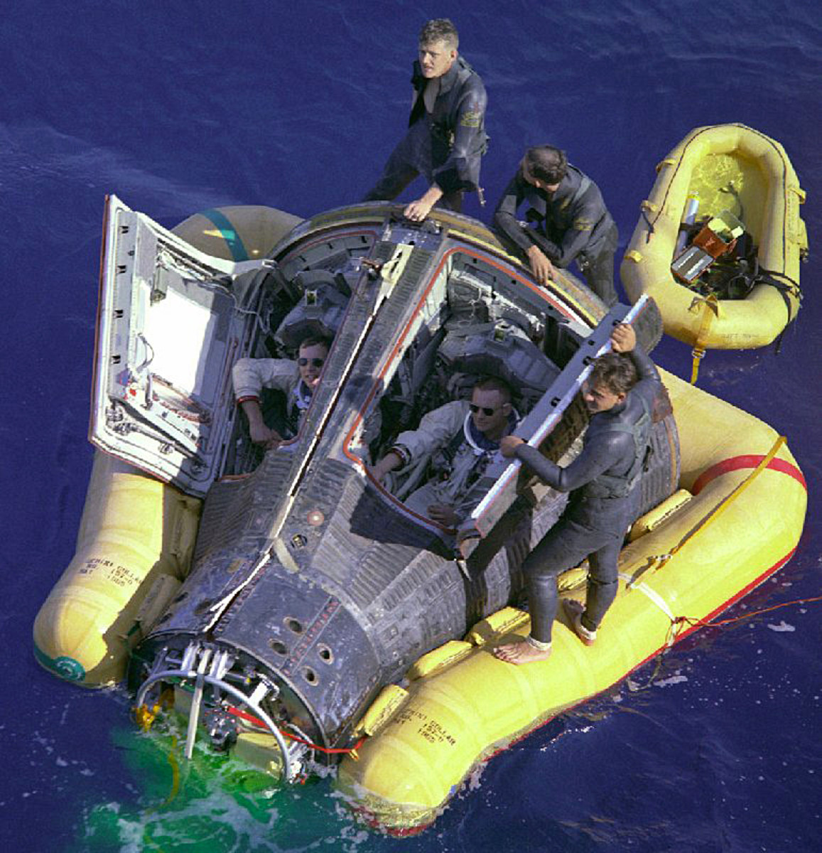 Gemini 8 capsule following splashdown in the western Pacific ocean, approximately 800km east of Okinawa, the result of an emergency landing. Aboard the capsule are United States astronauts David Scott (left) and Neil Armstrong (right).