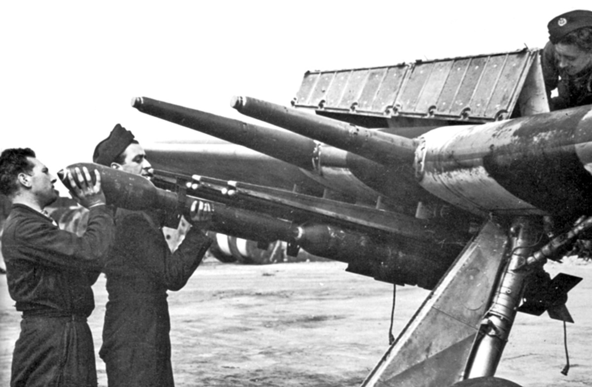 Ground crew load rockets into a Typhoon's launch racks. The cannons can be seen protruding from the wing.