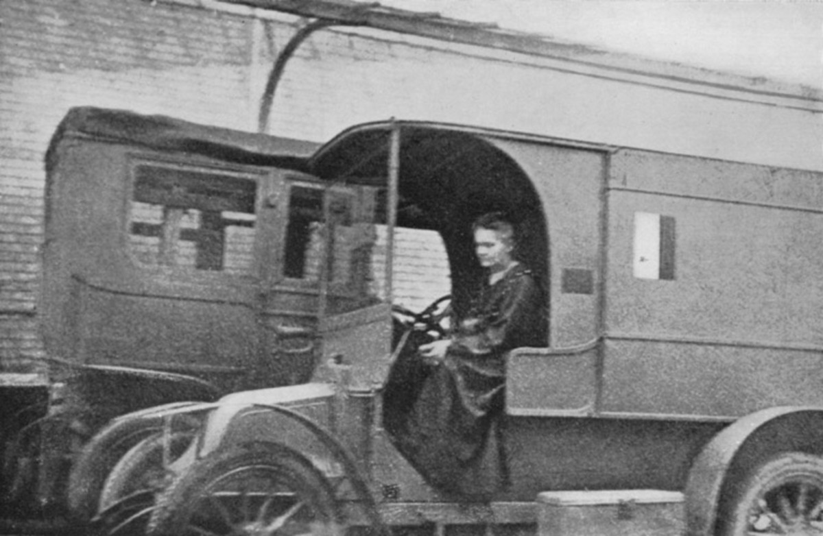 Marie Curie with mobile X-ray unit in World War I.