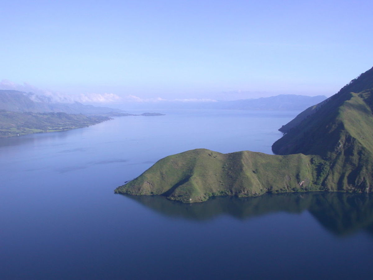 Lake Toba on the island of Sumatra in Indonesia sits on top of the site for the Toba Supervolcano