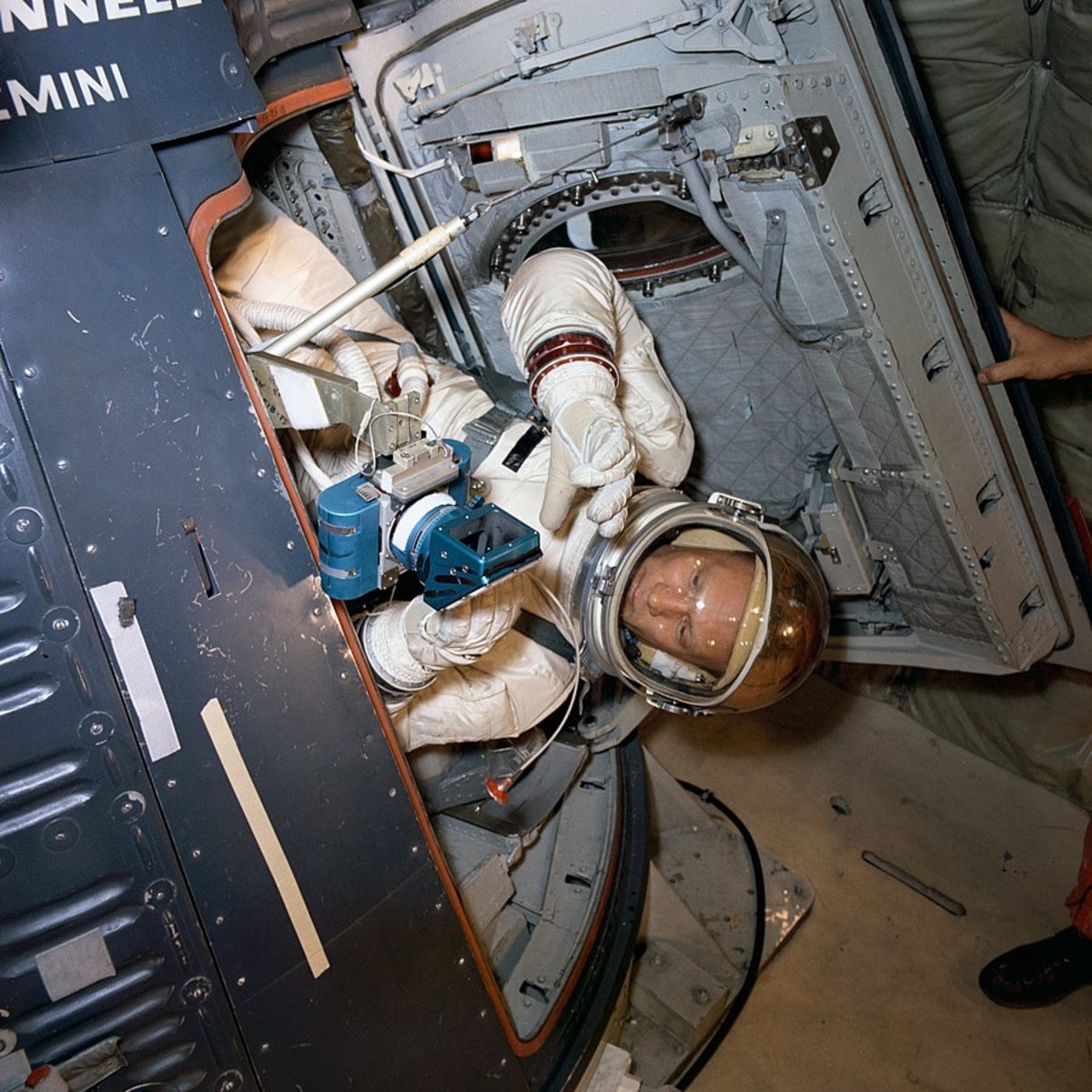 Astronaut Buzz Aldrin, Prime Crew pilot of the Gemini XII space flight, undergoes zero-gravity ingress and egress training aboard an Air Force KC-135 aircraft. He practices using camera equipment.