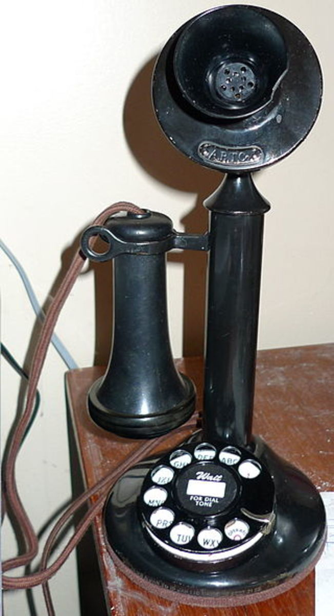 The slim upright phone with a receiver and a mouthpiece and a rotary dial.  Popular in the 1940s