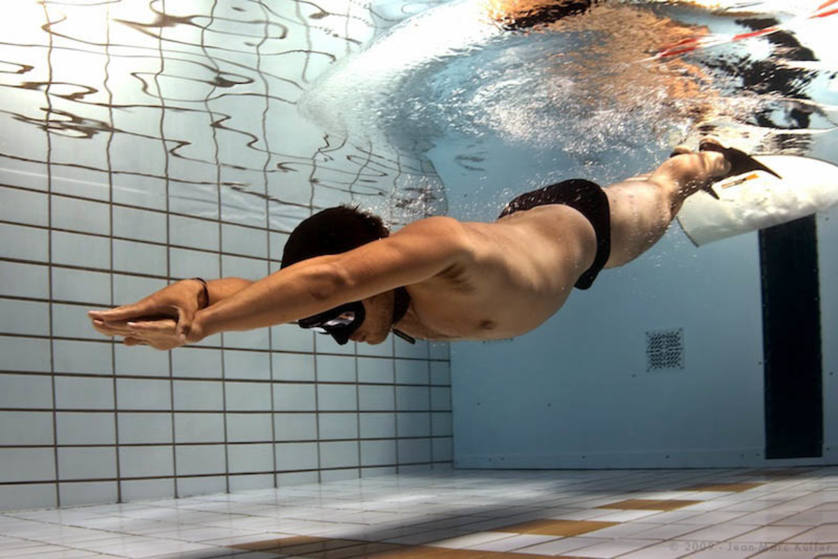 Both aerobic and anaerobic respiration are chemical processes which take place inside cells. If this swimmer stays underwater until he's used up all the oxygen in his held breath, his muscle cells will switch to anaerobic respiration