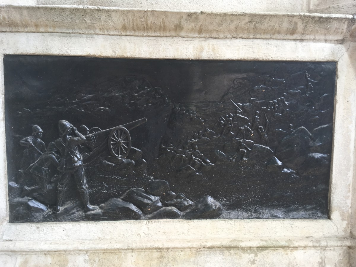 Bronze relief depictiong the Royal Marines and Naval Brigade employing their guns in action in South Africa - details from the Royal Marines Memorial