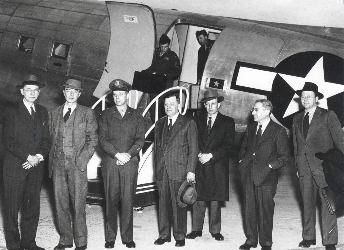The General Advisory Committee  of the Atomic Energy Commission arrives at Santa Fe, New Mexico, Airport on 3 April 1947. L to R: James B. Conant, J. Robert Oppenheimer, Brigadier General James McCormack, Hartley Rowe, John H. Manley, Isidor Isaac