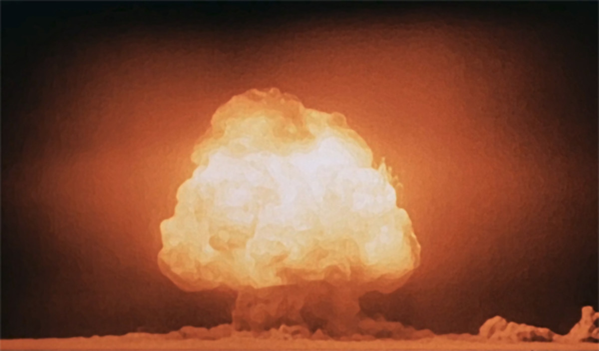 Mushroom cloud of the test of the first atomic bomb at the Trinity test site, seconds after detonation.