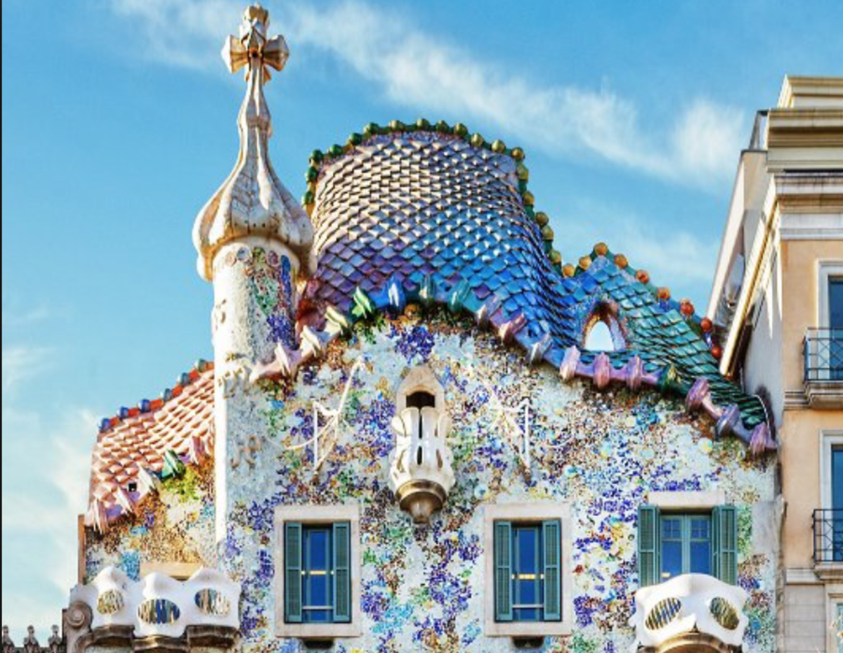 The rooftop of La Casa Battló.  Notice the curves of the rooftop and the colorful, scale-like mosaic shapes that resemble dragon scales. Many say that Gaudi wanted to evoke the image of a dragon with this design.