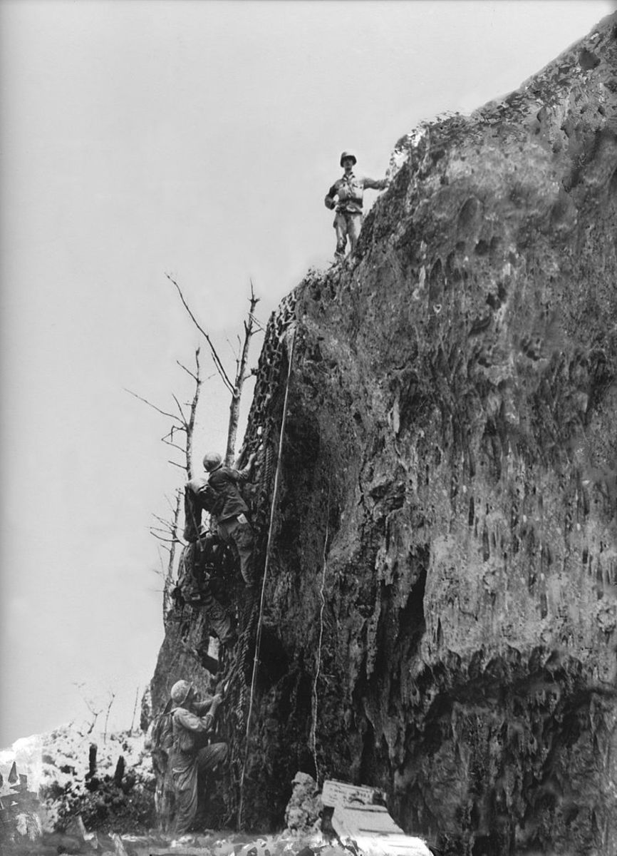 Picture of Doss atop Hacksaw Ridge. It is here that Doss lowered over 75 injured soldiers down to safety.