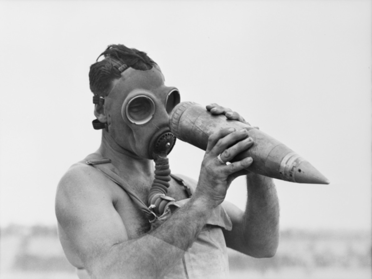 Australian soldier investigates chemical weapon shell that failed to explode.