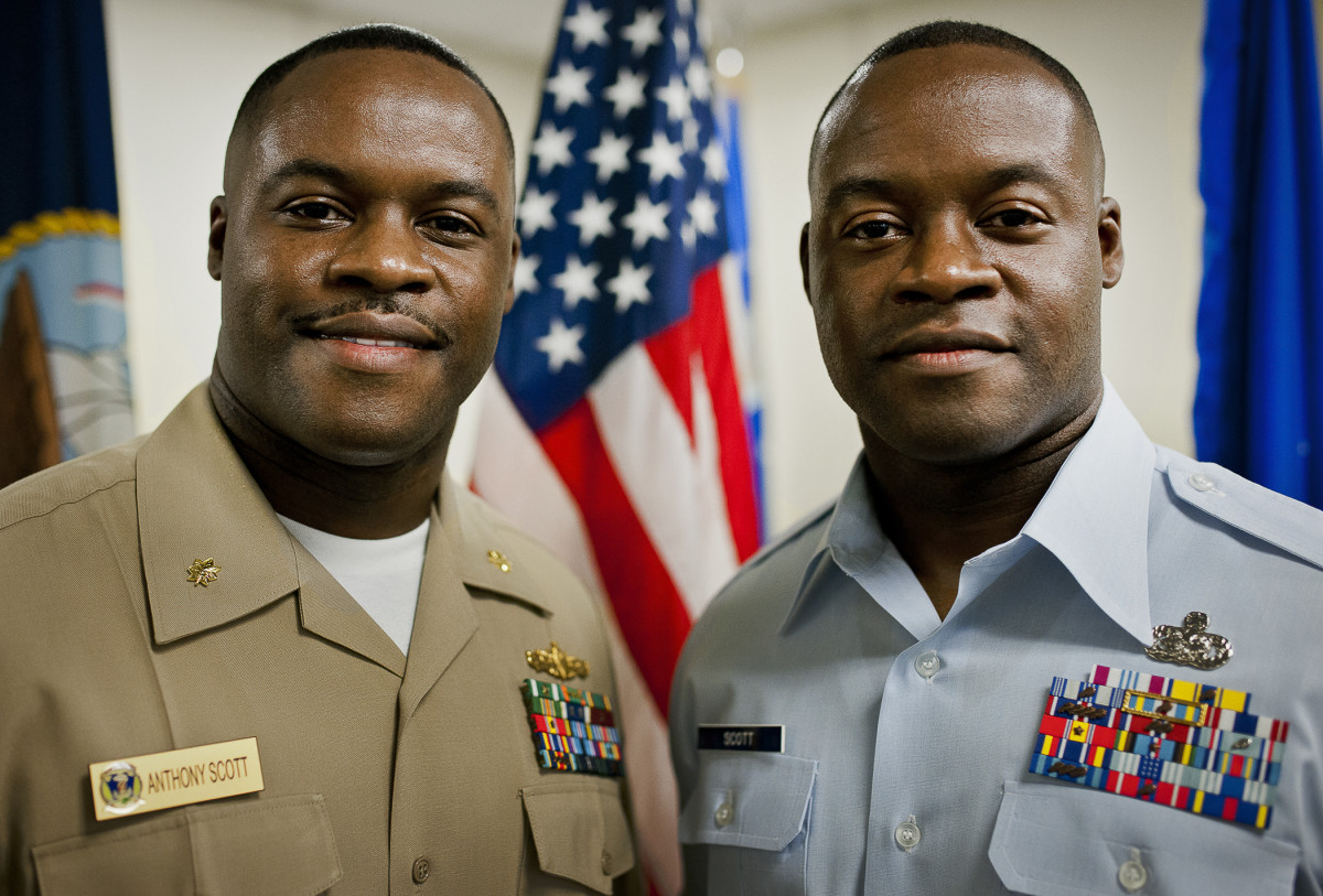 Identical twins in the U.S. military, but look closely and you'll see subtle differences.