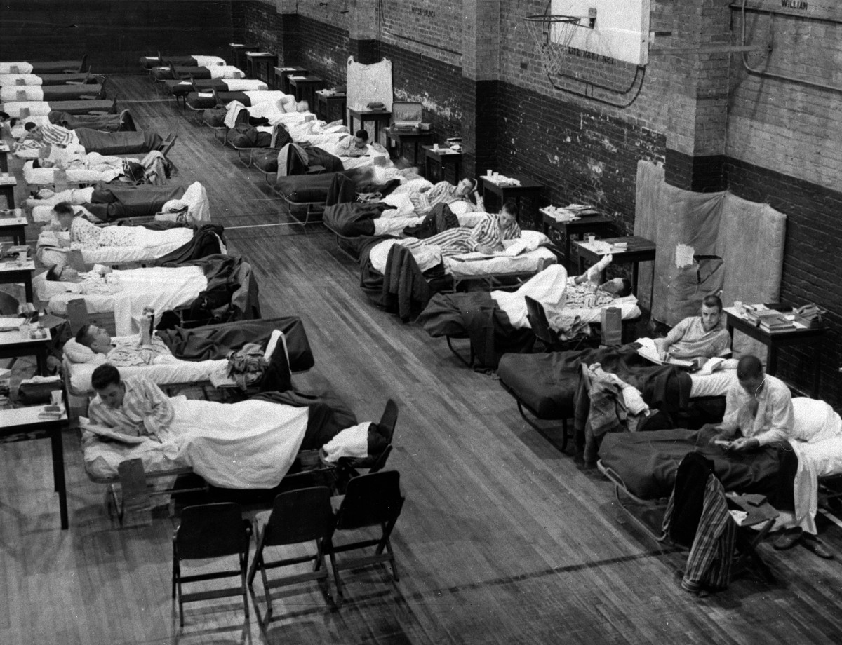 School infirmary in Georgia tech became overcrowded so students who have the flu were placed in a naval armory as seen in the photo...by: wahingtonpost