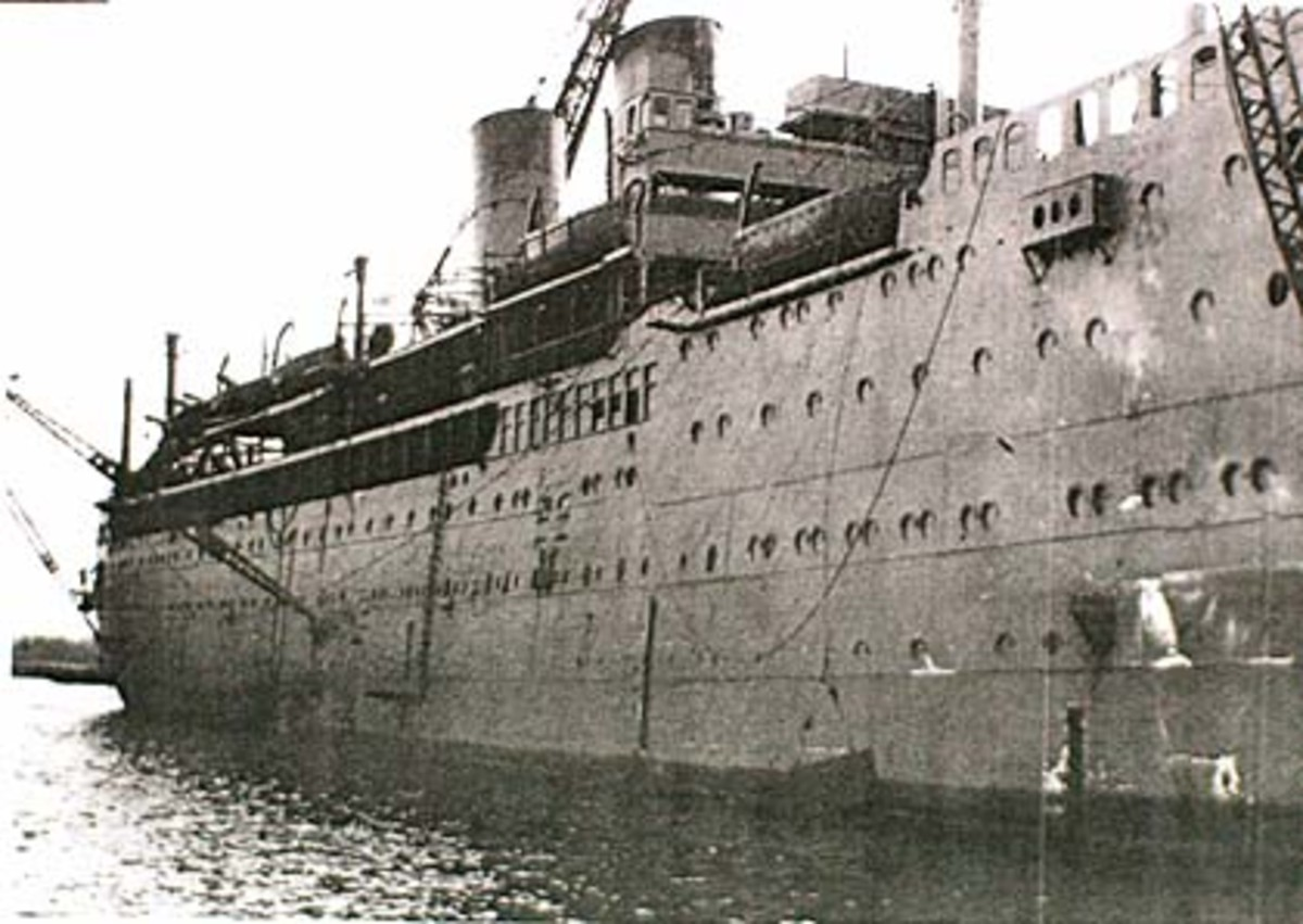 Having lost her sparkling cruise-liner livery, the Aranadora Star is now painted in wartime grey.