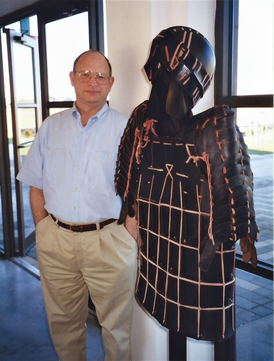 This armor was leather stitched together to give the soldiers flexibility. Photo of my husband standing next to it.