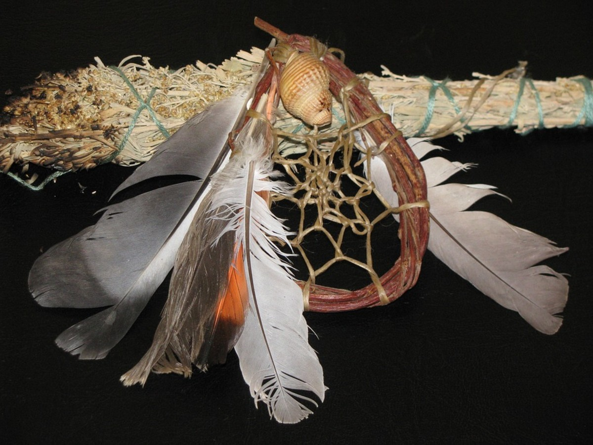 A traditional dream catcher and a smudge stick that is used to spread ceremonial cleansing fragrances in a dwelling or longhouse.