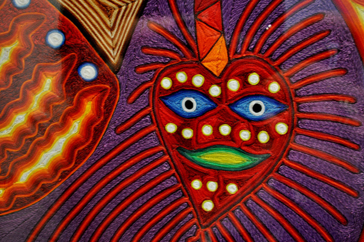 Huichol brightly embroidered art piece.