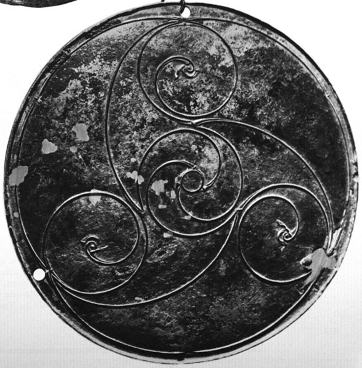 Celtic whorl in a triskele arrangement, pre-Christian. Source: GubPowderMa - wikicommons.
