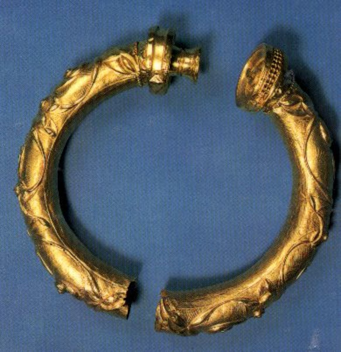 Broighter Collar - a photograph of a gold torque type collar, thought to have been crafted around 100 AD. Possibly belonged to a warrior. Found by Thomas Nicholl in 1896, whilst ploughing a field.