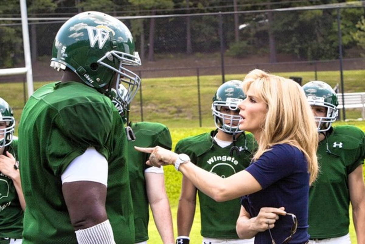 "The Blind Side ""Michael"" and ""Leigh Anne.""  Michael was not happy that the movie made it appear he did not know how to play football."