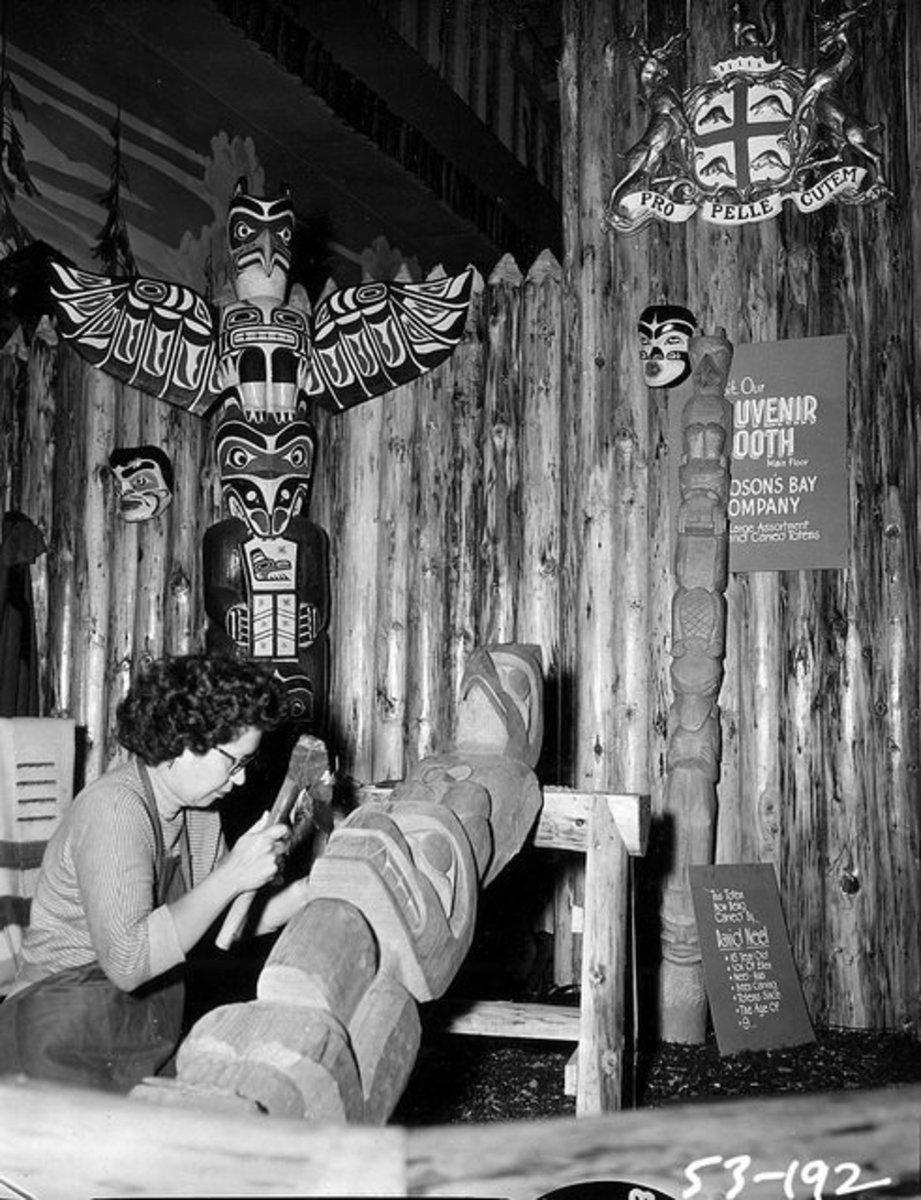 Kwakiutl carver Ellen Neel carving a totem pole.