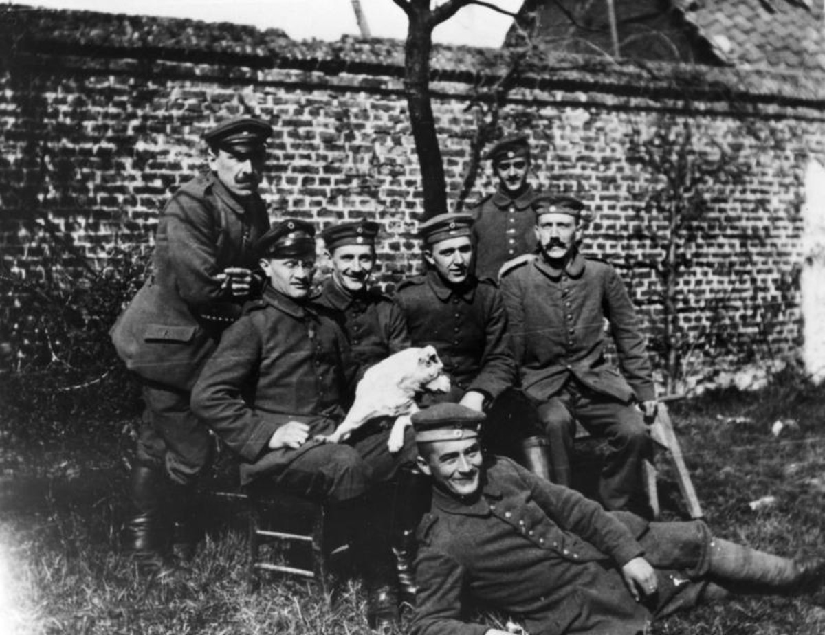 WW1: Adolf Hitler, aged 25, (seated far right) with his war comrades of the Bavarian Reserve Infantry Regiment 16.