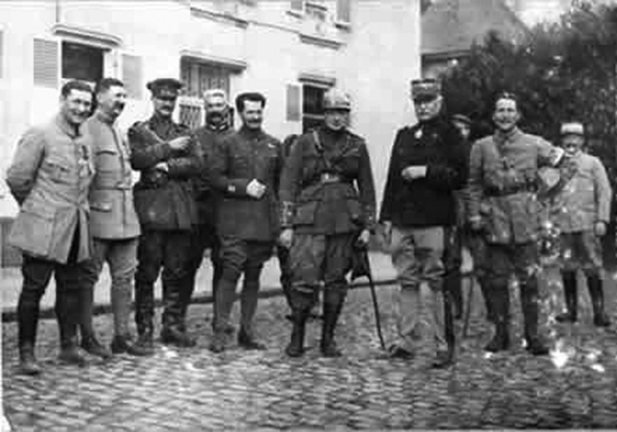 WWI: Churchill, center, wearing his French steel helmet, at French army headquarters at Camblain L'Abbe, 1915.