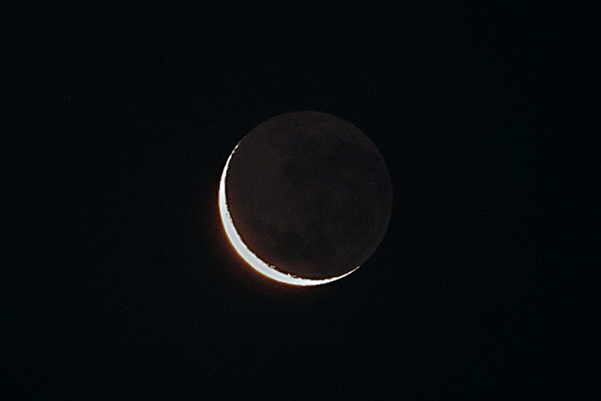 When there is a crescent Moon with little sunshine illuminating the daylit part of the near side, the very faint glow of earthshine - sunlight reflected off the Earth on to the night side of the Moon's disc - is apparent