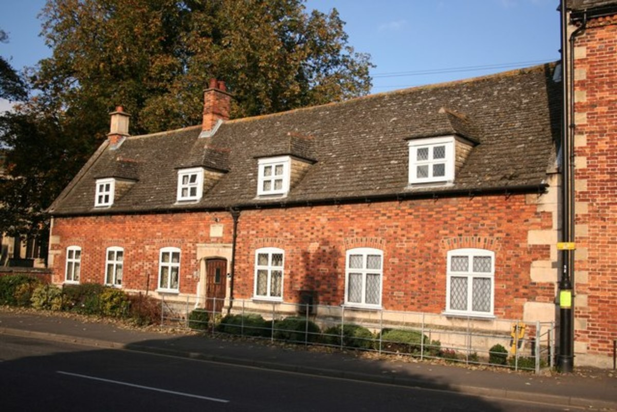 A 19 century almshouse, perhaps built with materials from an earlier almshouse on the same site.  This would be similar to the one Trollope describes as Hiram's Hospital in The Warden.
