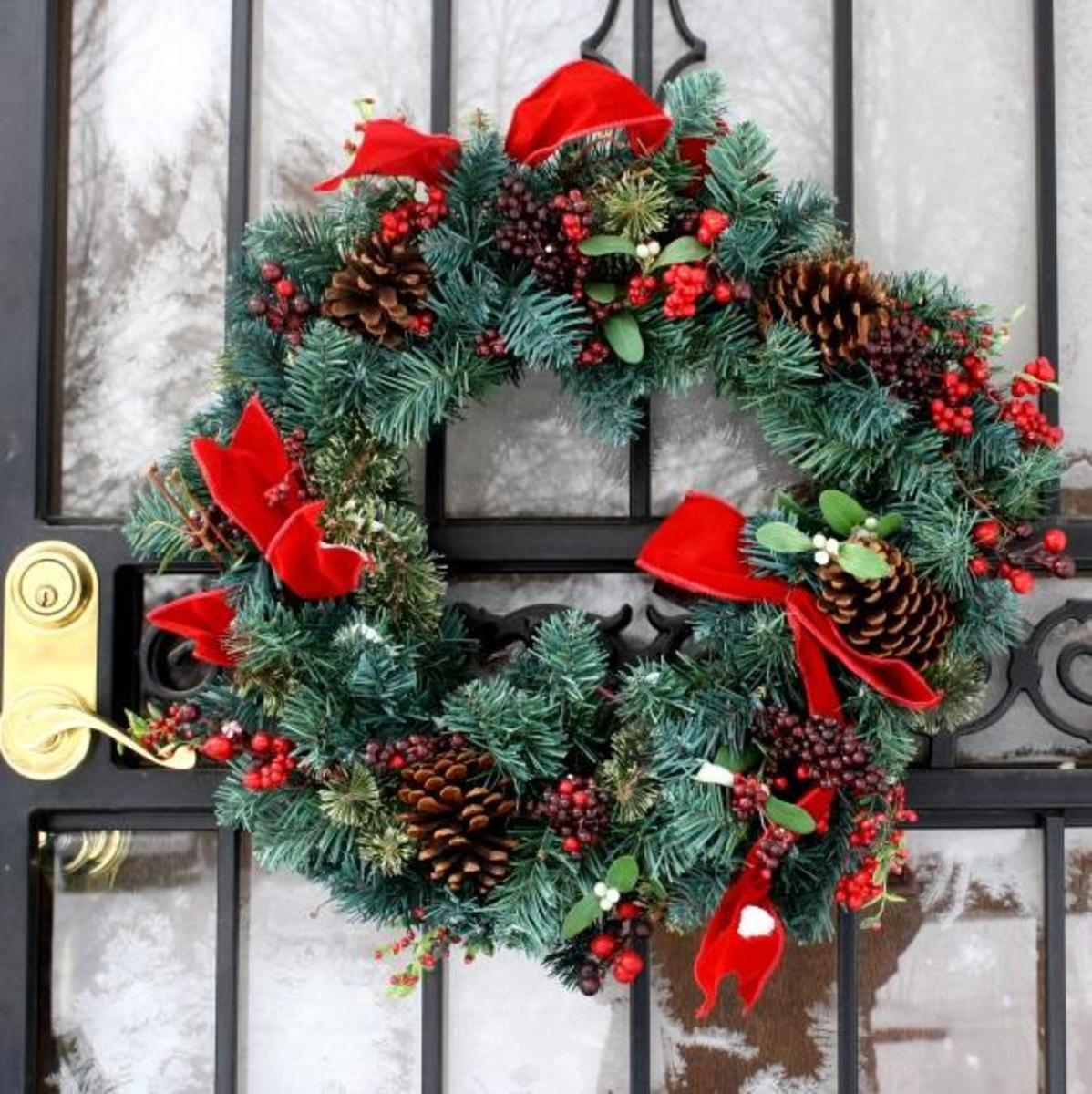 An attractive Christmas door wreath, decorated with mistletoe