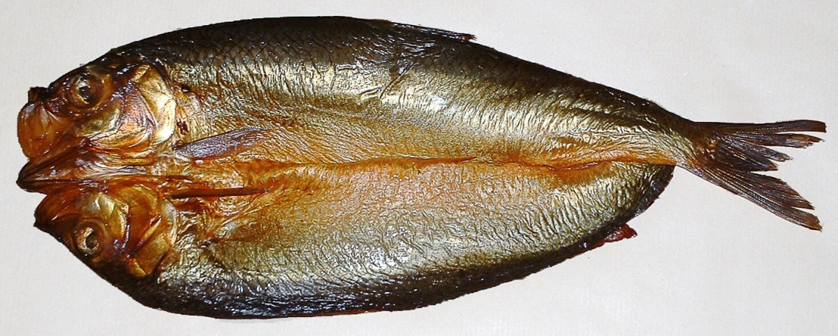 This is a split, gutted and smoked kipper, which is a type of herring. Kippers which are completely red have often been coloured artificially to shorten the smoking time.