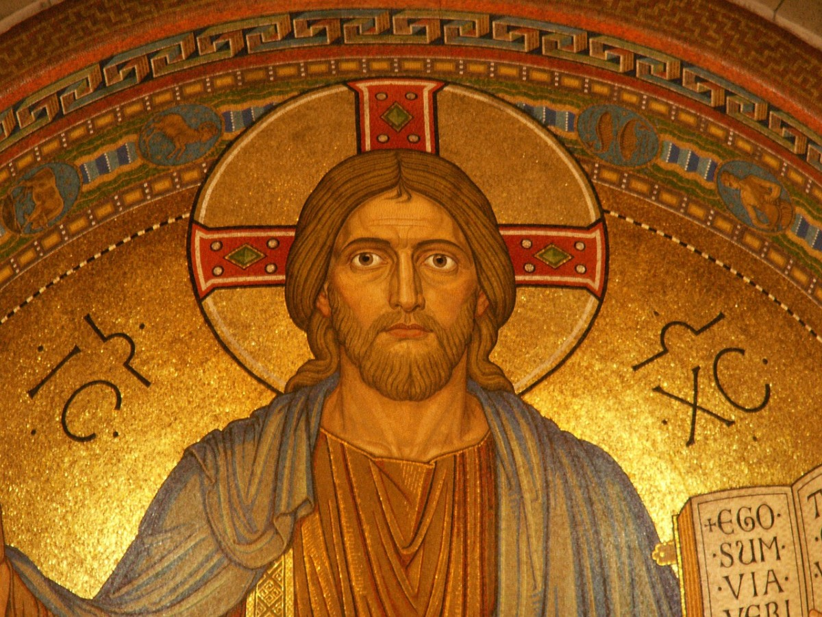 Why is Christ often depicted with a golden orb behind his head?
