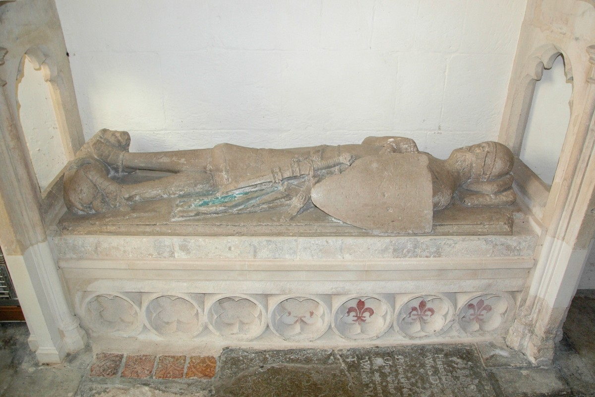 Fleurs-de-lis at the bottom of the tomb of Robert FitzElys in St. Mary the Virgin Parish Church, Waterperry, Oxfordshire; the fleurs-de-lis are the red drawings on the right of the tomb