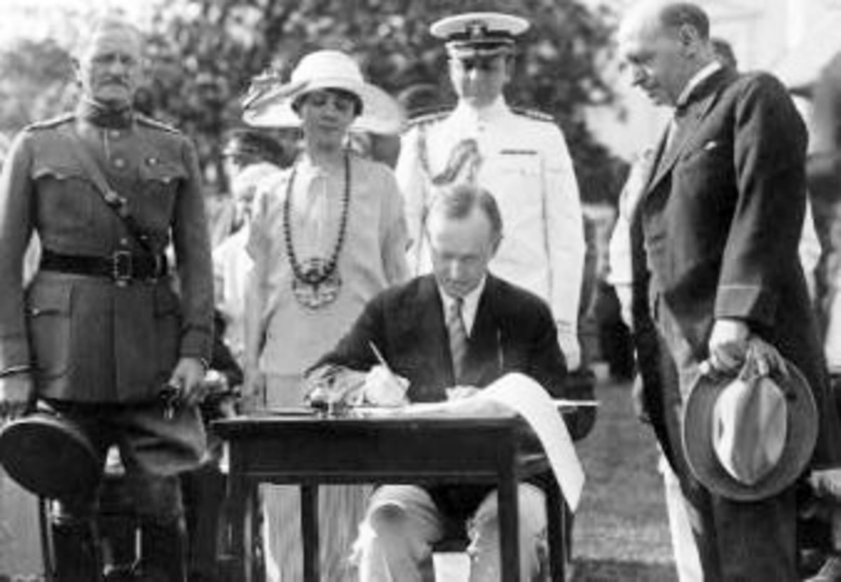 President Coolidge signing appropriation bills for the Veterans Bureau on the south lawn during the garden party for wounded veterans