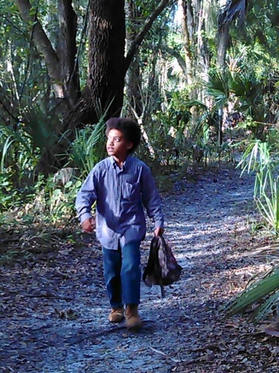 Nicholas taking a stroll through one of the hiking trails at a local historic site called Sam's House.  He is such a hands-on learner.