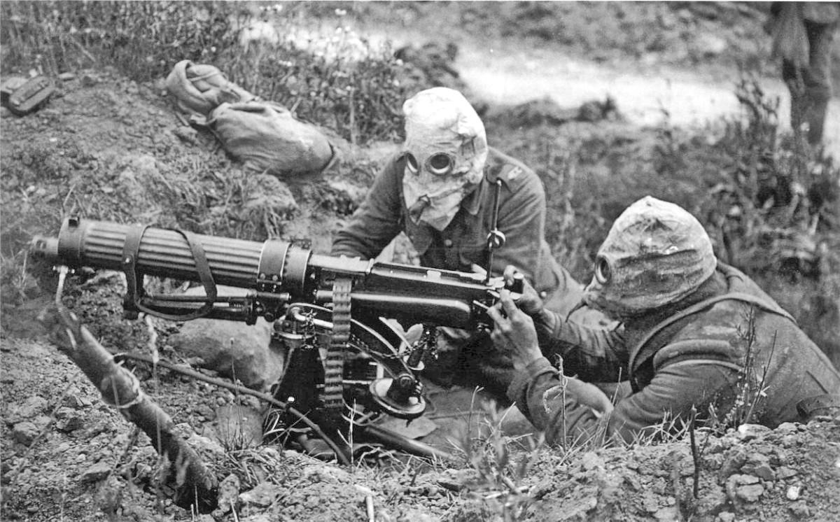 Machine gun team in action during a gas attack on the Western Front 1916.
