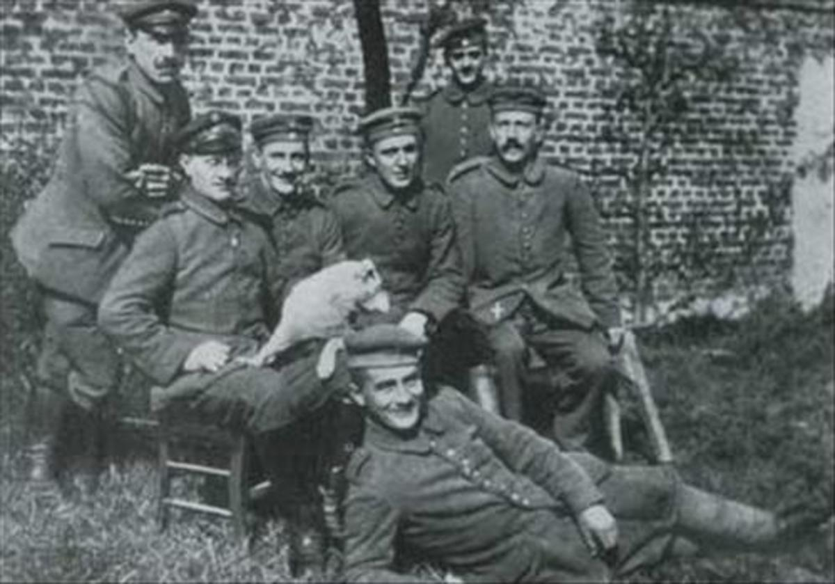 Hitler, seated at right, with WWI comrades.