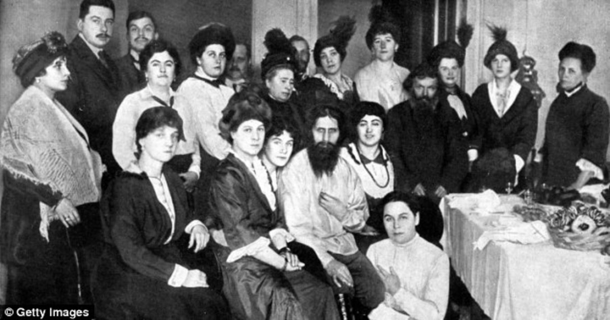 The mystic Rasputin (centre) held court with the Tsar and Tsarina