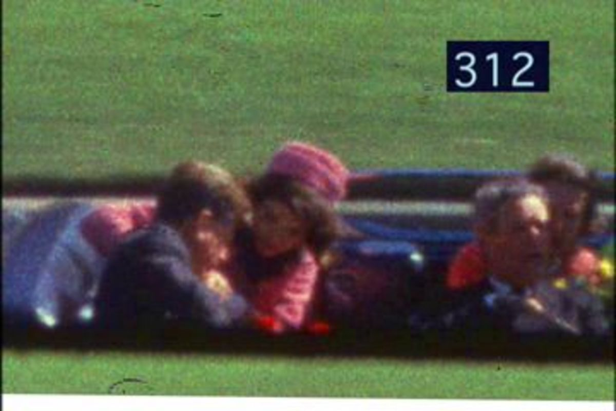 Frame 312 of the Zapruder Film: the president has been shot once.
