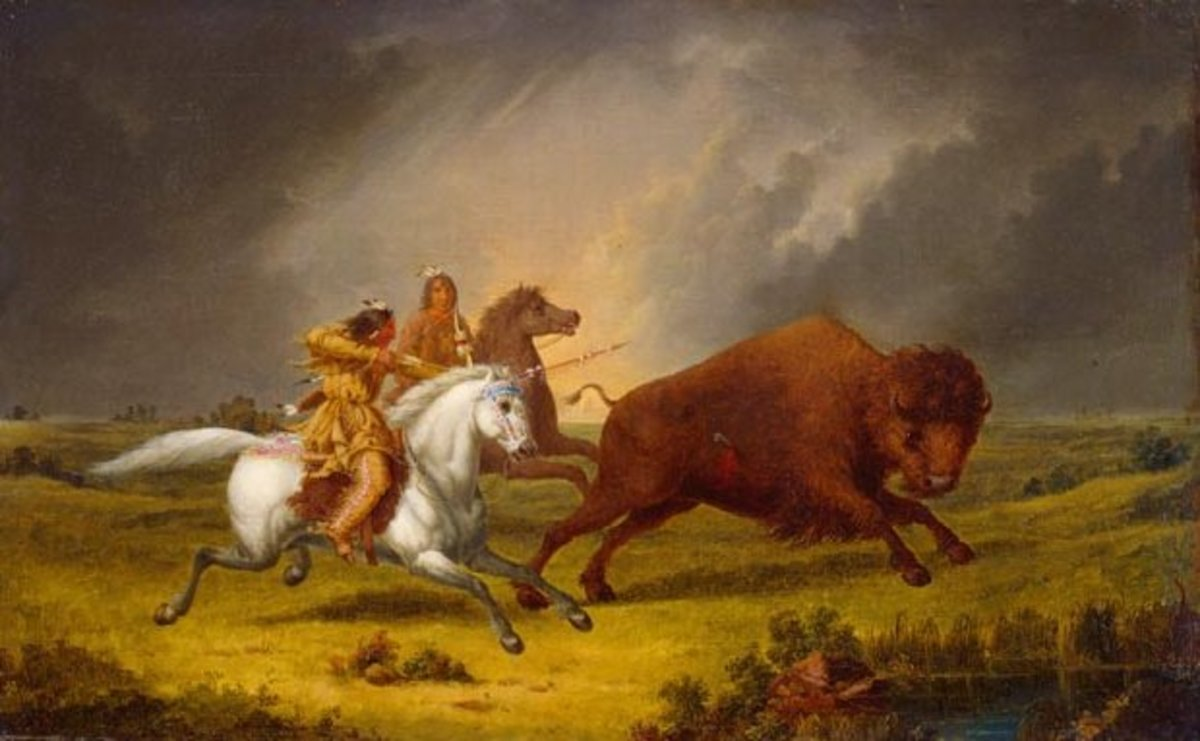 Plains Indians hunting buffalo with bow and arrow.