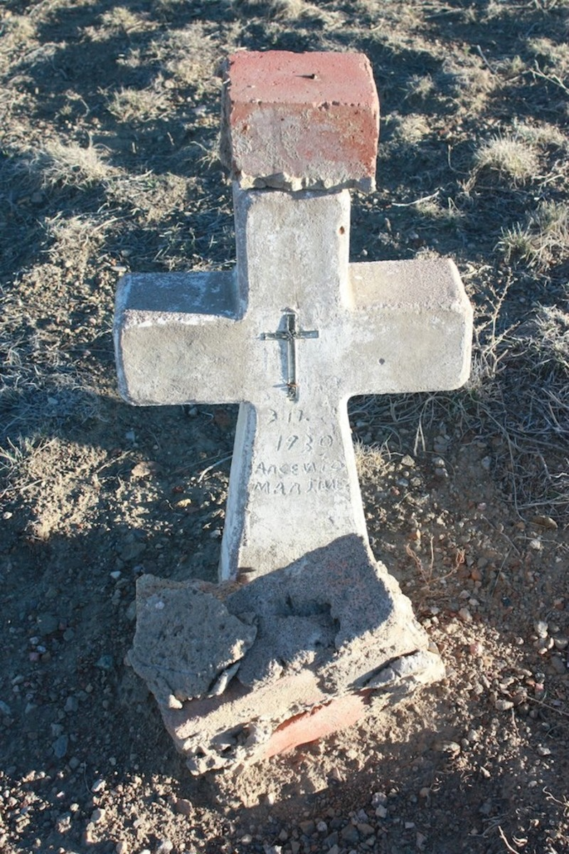 Headstone at the San Juan Bautista Cemetery.  Many of the cement stones are falling apart; most of the old wooden crosses have deteriorated.