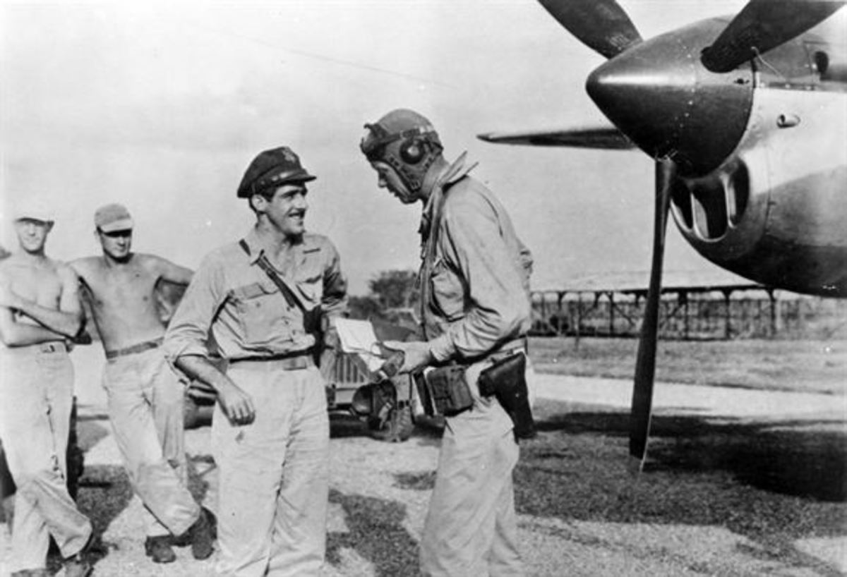 Lindbergh with Maj. Thomas B. McGuire (left). During the summer of 1944, Lindbergh visited the Southwest Pacific Theatre and devised economical flight techniques to extend the range of P-38 fighters.