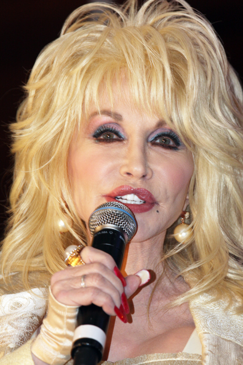 The Country and Western singer, Dolly Parton.  Certain styles of music were thought to have a neutral effect on plants, according to Retallack, that's to say, neither good or bad.  Country music was one of them.