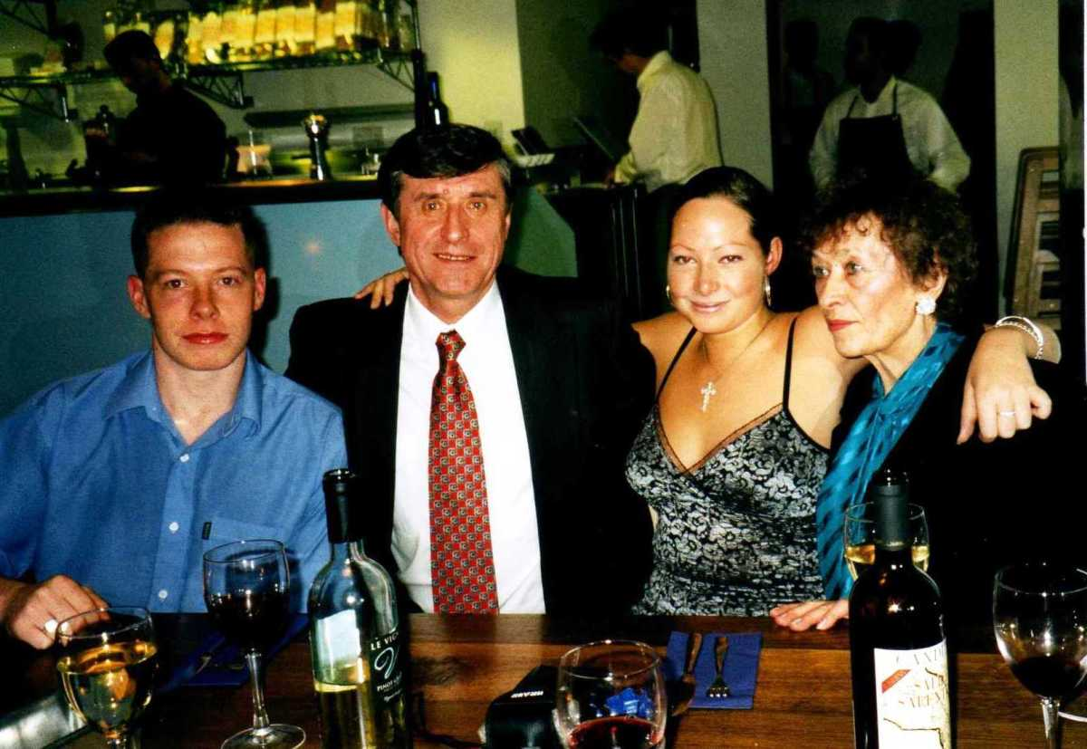 Stepan (centre left) and Lina (right), with Graham's two children Alasdair and Kerry.