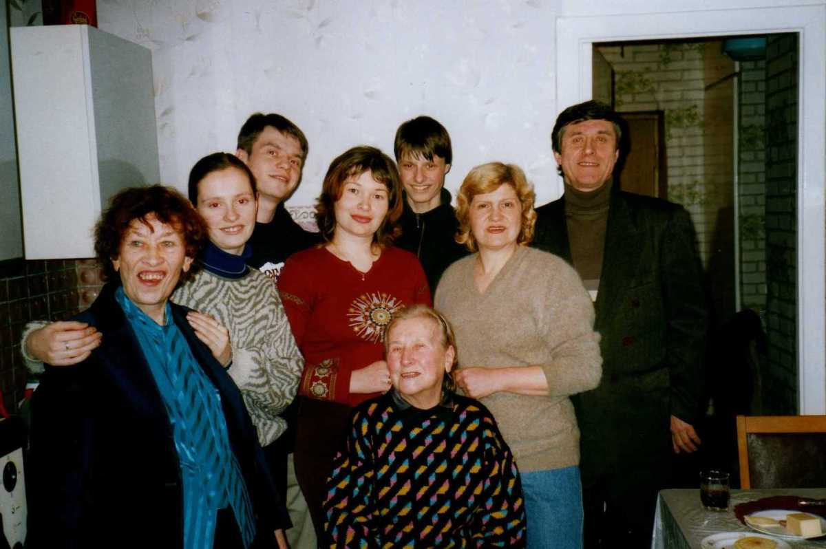 From left, Lina, Stepan's daughter Masha, oldest son Fedor and his wife Elena, youngest son Dima, Stepan's wife Lida, and Stepan himself. Front seated, Lina's sister Nina Fedorovna.