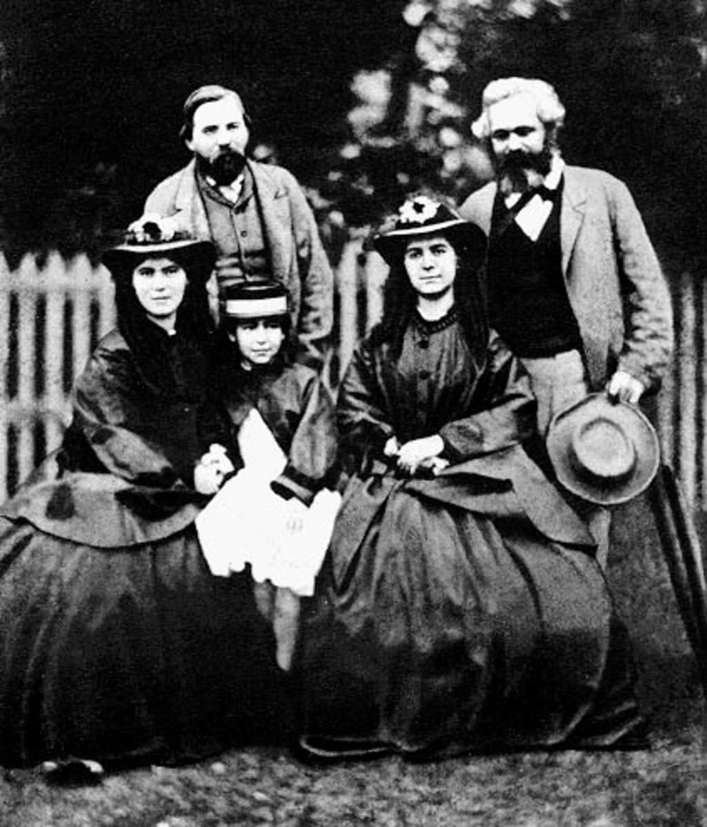 Marx and his daughters alongside Engels.