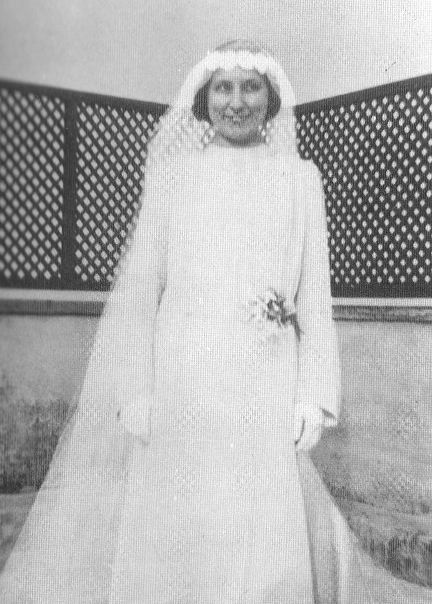 Julia is shown in a wedding gown on June 24th, 1938, shortly before becoming a Camaldolese novice. It was the custom in those days for the pre-novice to wear a wedding gown during the ceremony, as a symbol of her being wedded to Christ the Bridegroom