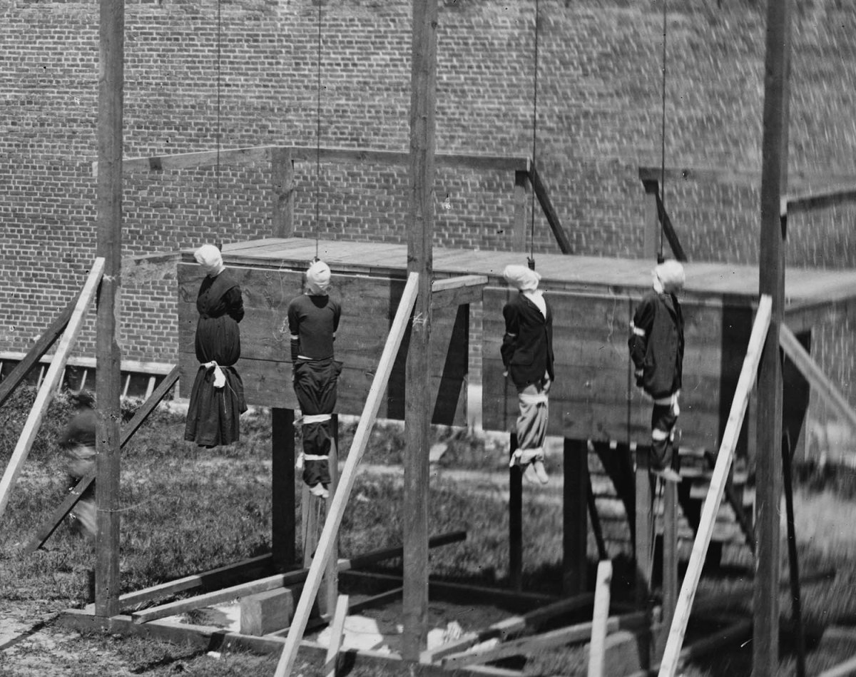 The execution of Mary Surratt, and her three co-conspirators. From left to right: Mary Surratt,  David Herold, Lewis Powell, and George Atzerodt