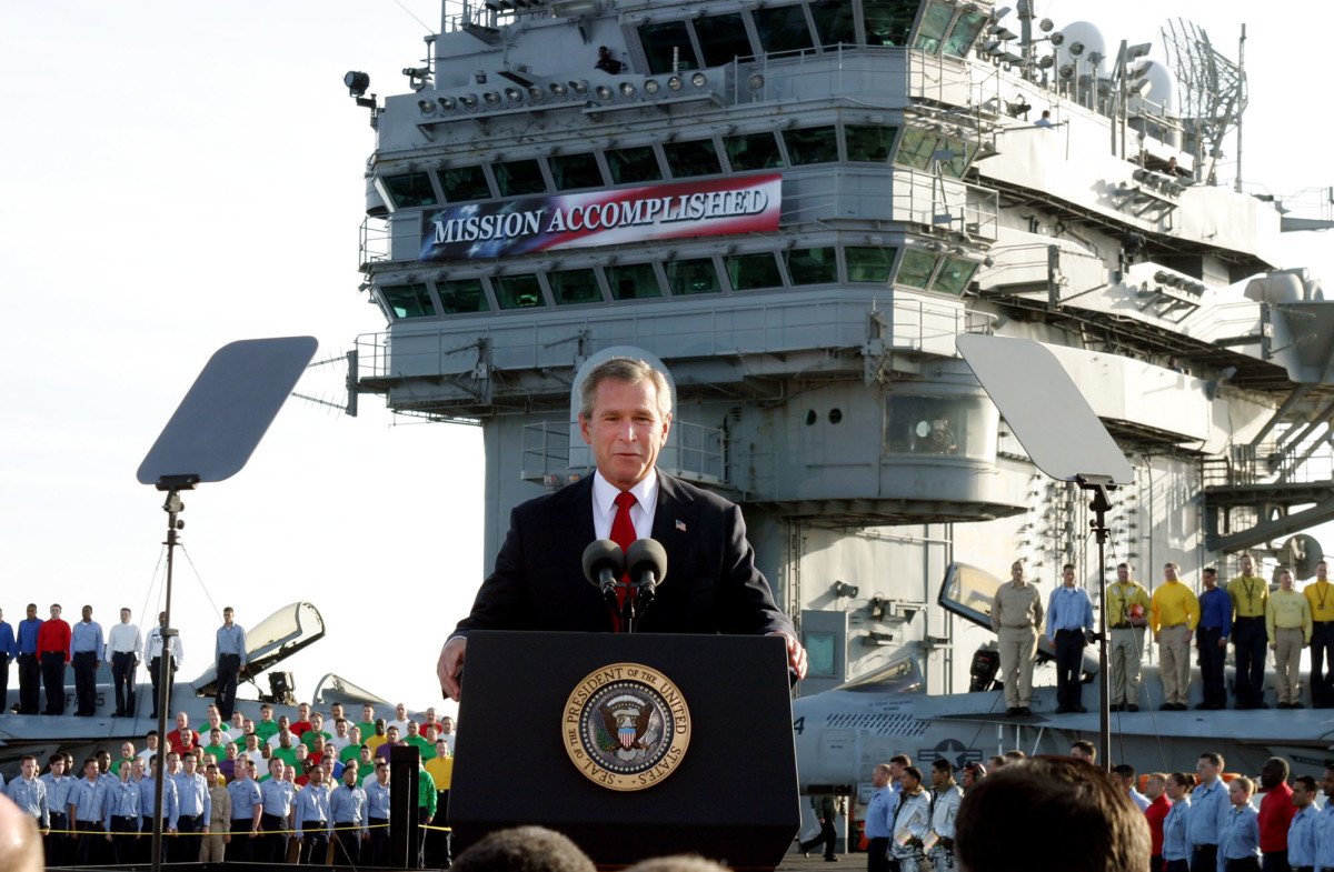 Then-President Bush stands on the deck of the carrier USS Abraham Lincoln in 2003.