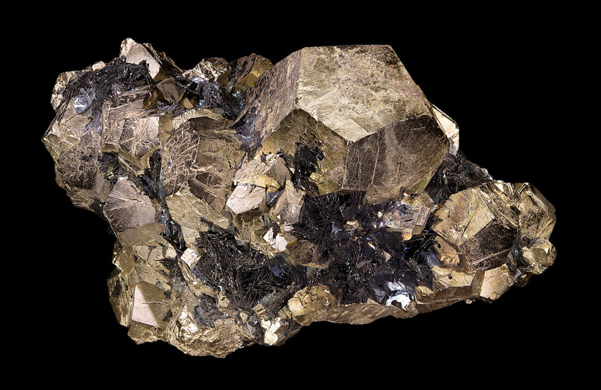 Pyrite is comprised of iron (Fe) and sulphur (S) and often forms cuboidal crystals, as pictured above.