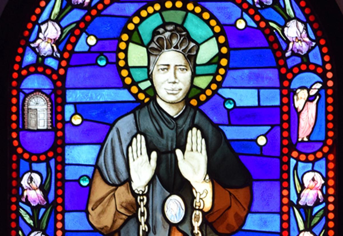 This stained glass shows St. Josephine Bakhita with her chains broken.